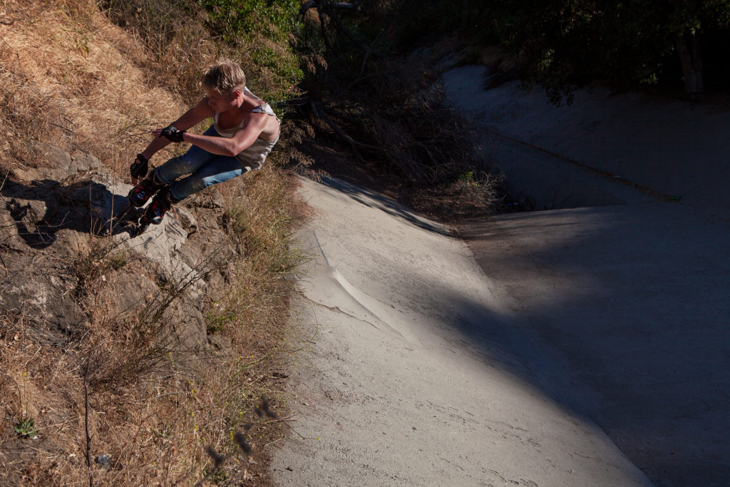 Wallride on a rock at the Bronson Ditch in Los Angeles on the Flying Eagle F110 skates.