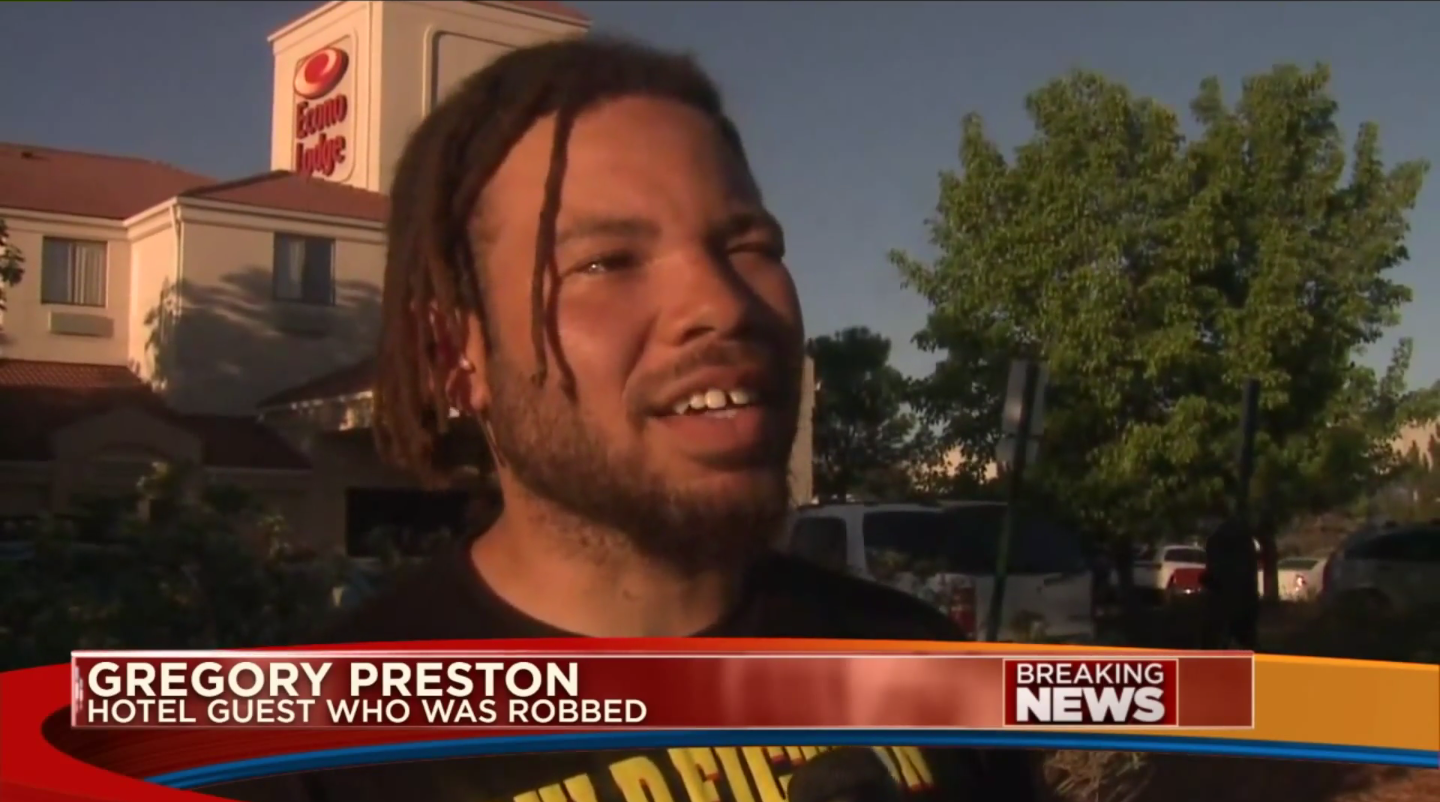 Gregory Preston talking to the news